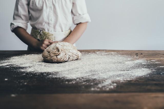 Bakery business owner preparing bread