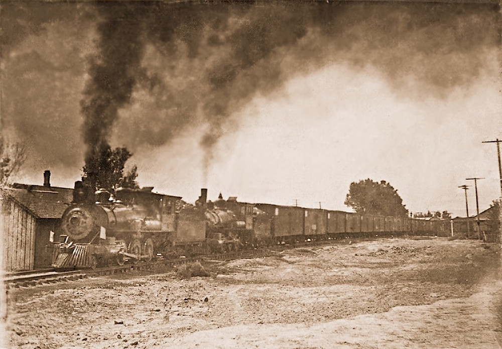 First Colorado Midland Railroad train loaded with Palisade peaches in the 1890's