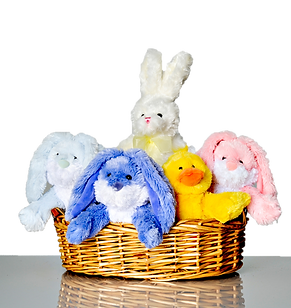 Basket of cute bunnies and a duck. Microwavable, heat cold aromatherapy for healing and comfort.