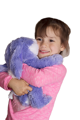 Autistic girl holding a weighted heat cod and aromathrapy plush bunny.