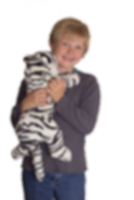Comfy Buddy white tiger bein held by autistic boy for comfort and grounding.