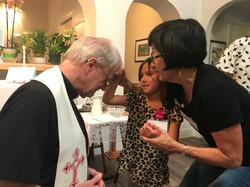 Child praying for Fr Bausch