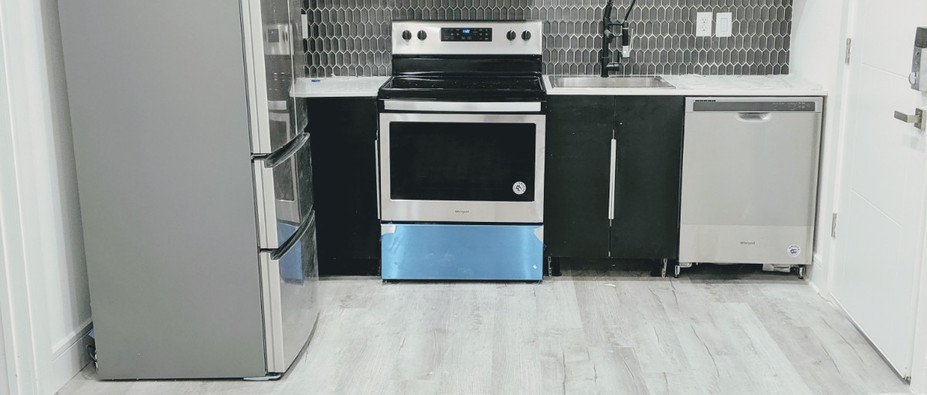 Kitchen with grey subway tile backsplash