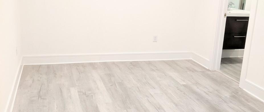 Plank wood flooring throughout