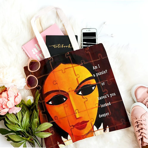 'Woman is a puzzle' Tote bag