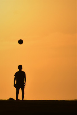 silhouette boy and ball