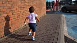 Little boy running around