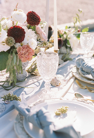 Beach Wedding Table Settings with torn placecard and dusty blue linen