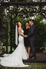 Bride and groom laugh in a wedding ceremony with Officiant Amber
