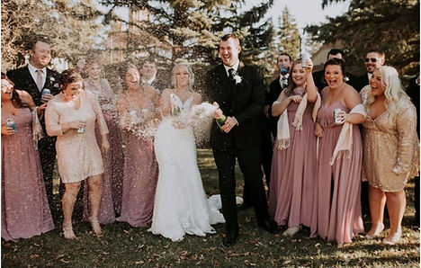 Officiant Amber services Fargo, Grand Forks and Moorhead. Couple pictured with Glasser Images