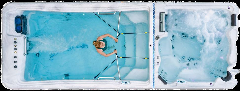 Woman using rowing system in dual-temp TidalFit swim spa