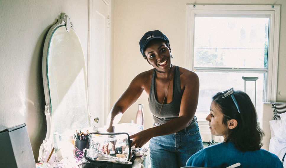 "MUA and actress Karen Obilom works with actress Cristina Rambaldi on set of ""Show Me What You Got"" - photo by Gianluca Sansevrino"