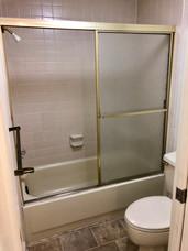 1 Bed - Bathroom Shower.jpg