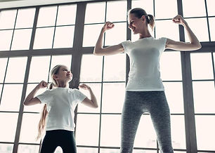 mom-daughter-working-out-home-attractive