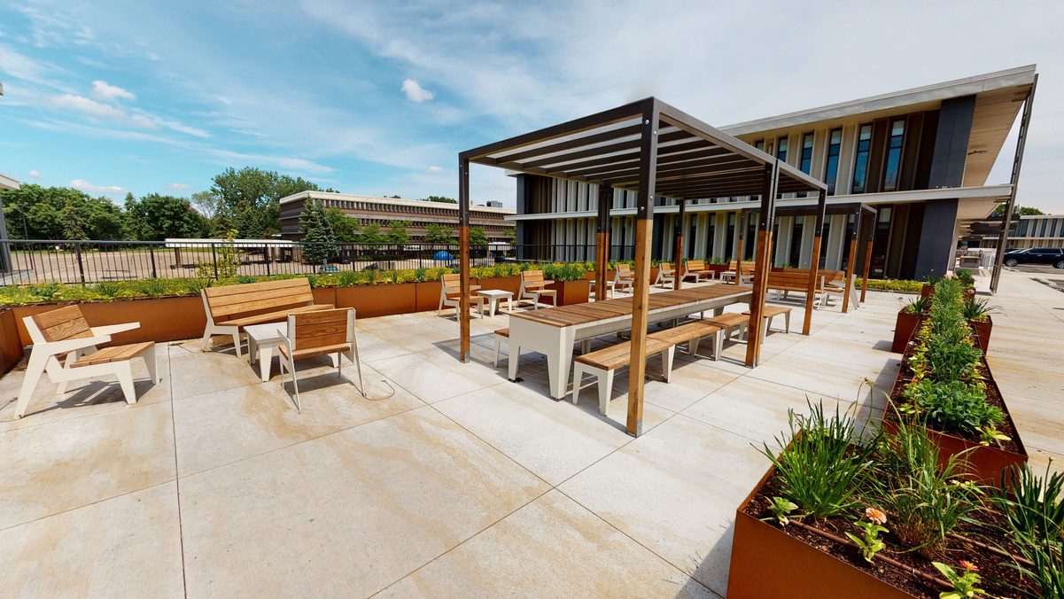 Shared Tenant Patio Spaces with Ample Seating Among MN Native Plantings