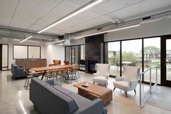 Shared Tenant Lounge with MCM Soft Seating, Kitchenette, Electric Fireplace