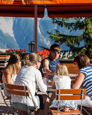 Family dining on the Terrace at Berghaus Toni Hotel in Summer