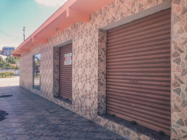 Loja com terreno e garagem (R. Iúna)