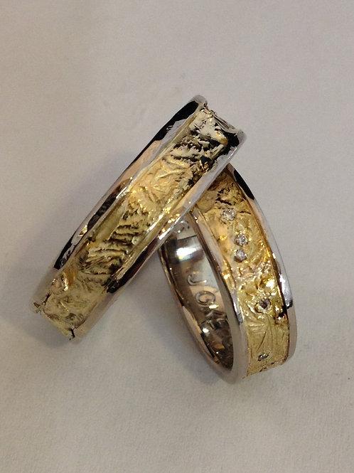 Geel gouden trouwringen met witgoud en diamantjes