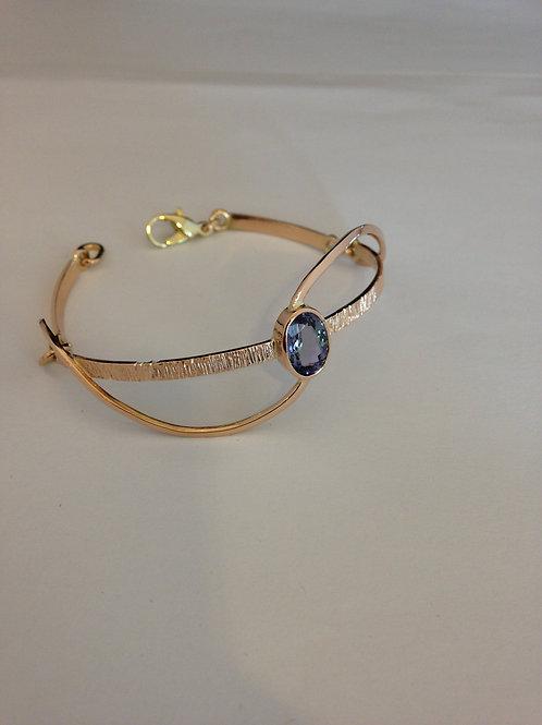 Gouden armband met steen hergebruikt