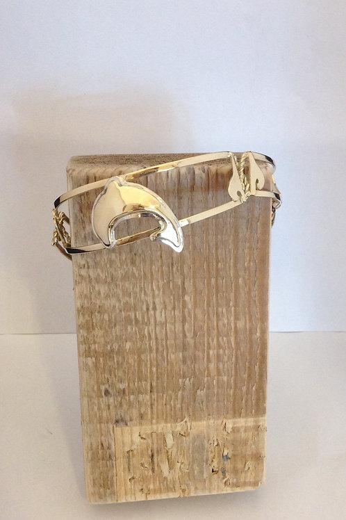 Zilveren/gouden armband met dolfijnen waarin as is verwerkt
