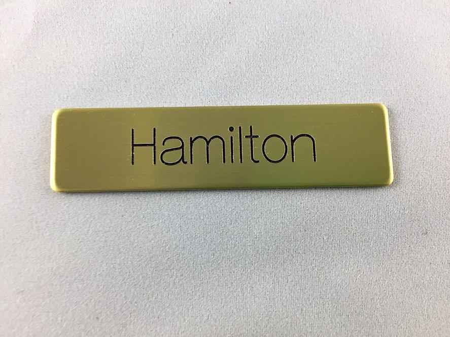 Engraved metal name tag