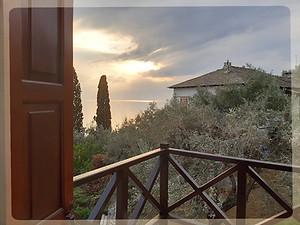 the bedroom balcony overlooking pagasitikos bay. views from Gatzea's ways beach house.