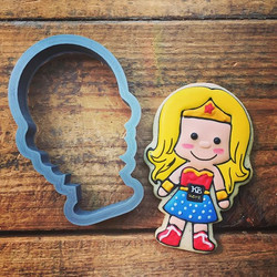 How about some custom Wonder Woman cookies complete with blonde hair and a company logo on her belt_