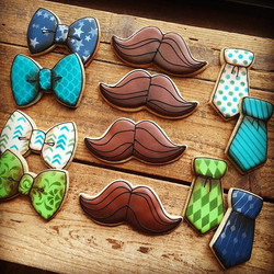 A dapper little man themed baby shower set complete with bow ties, mustaches, and neck ties