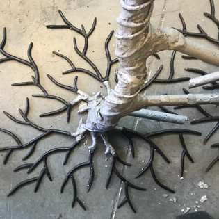 Wax roots to be cast in bronze