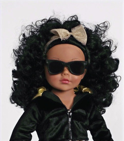 Doll with glasses face shot
