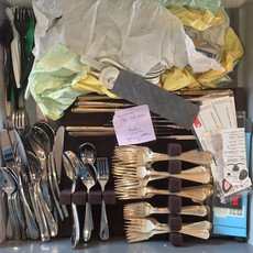 Cluttered Silverware Drawer Before Organizing