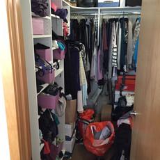 Unorganized Bedroom Closet Before Decluttering