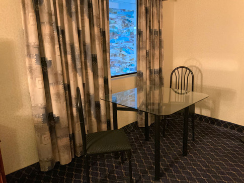 Guest room table with two chairs