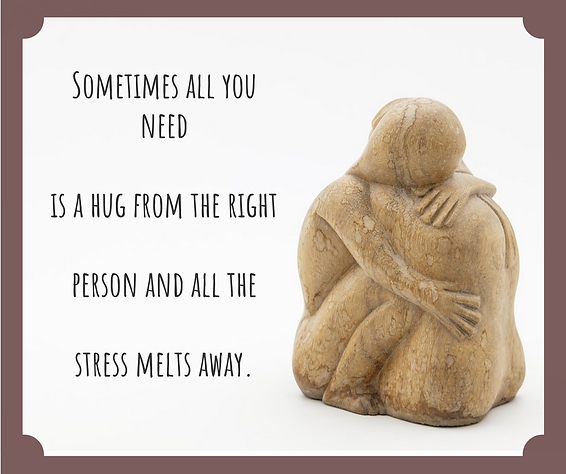 stone statue of two people hugging - sometimes all you need is a hug and all the stress melts away