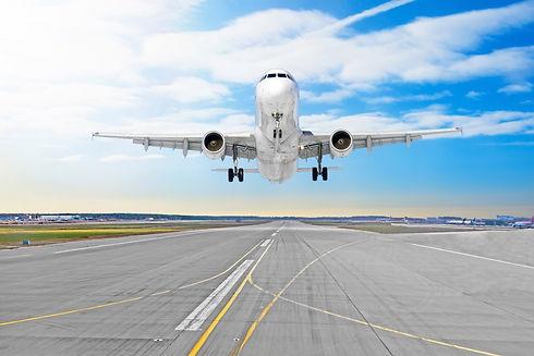 passenger-airplane-asphalt-landing-runway-airport.jpg