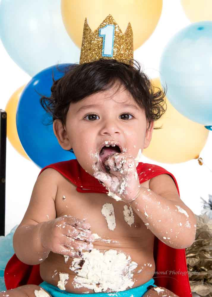 cake all over 1 year old during his little prince cake smash photo shoot