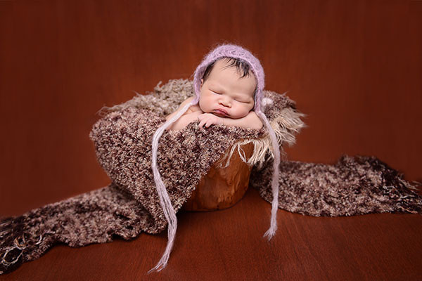 newborn baby sleeping in wooden prop, sydney baby photography