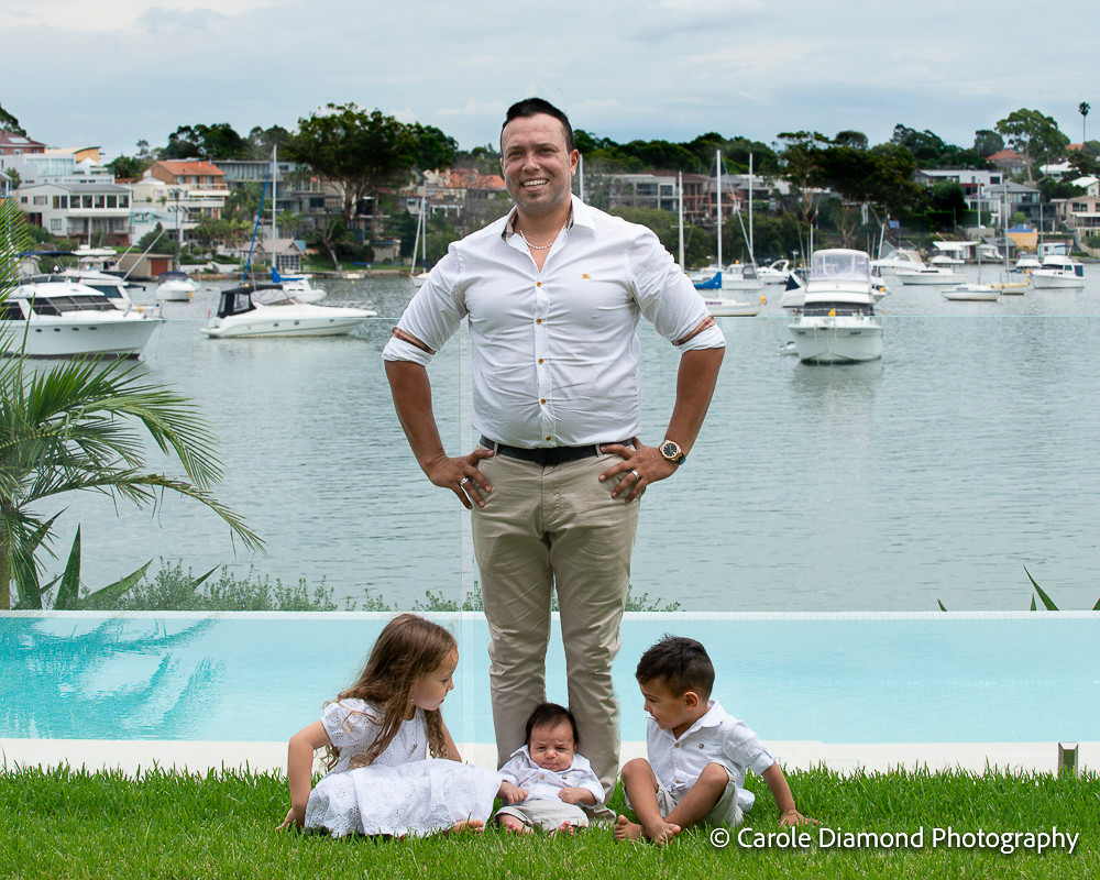 Wonderful father of 3 miss 4 master 2 and master newborn in the waterfront back yard, photography by Sutherland shire family photographer Carole Diamond Photography