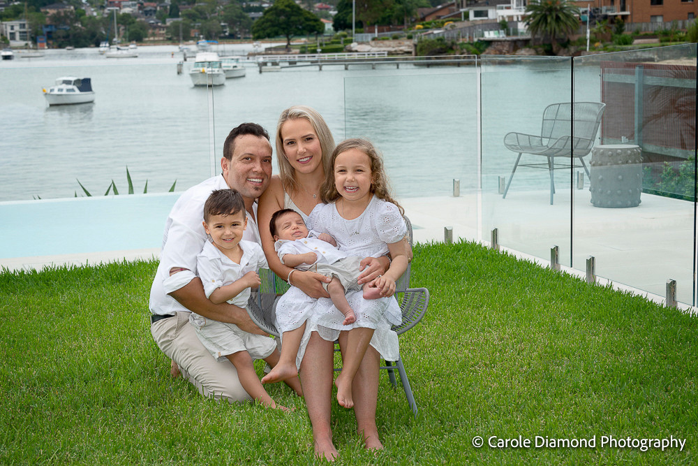 In home photography sitting by Sutherland Shire Family Photographer Carole Diamond Photography with this adorable family in their back yard at their Tennyson Point home!  this family shares so much love with each other and all.