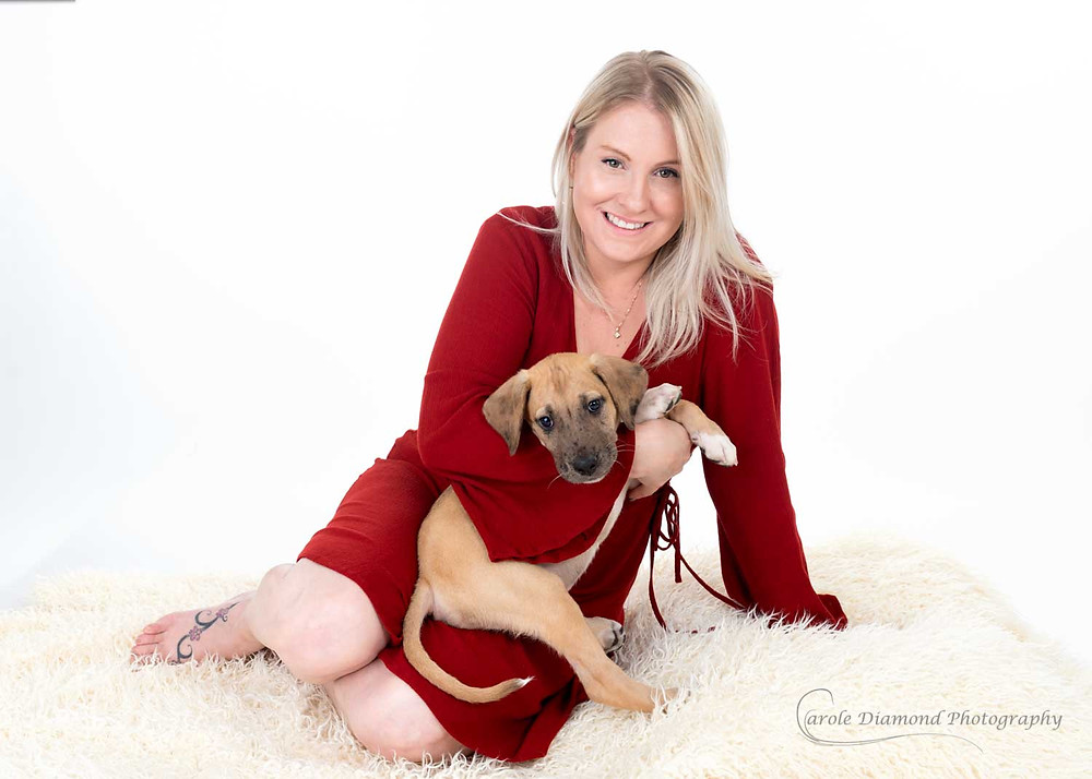 blond woman in red dress holding a cute photo by carole diamond photography