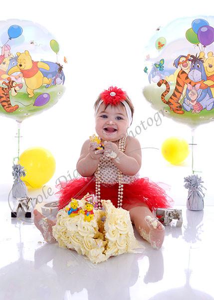 girls winnie the pooh themed cake smash photography sydney