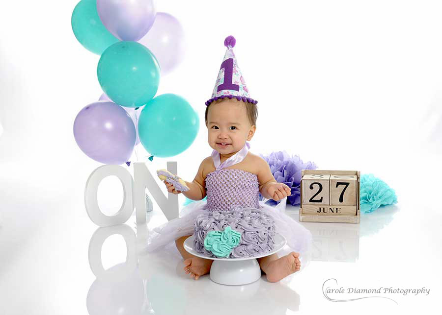 little girl in purple and teal for her cake smashes sydney
