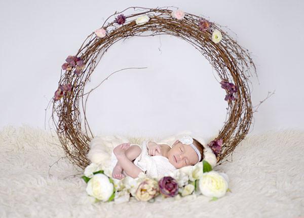Sleeping newborn baby in floral wreath, newborn photographer sydney