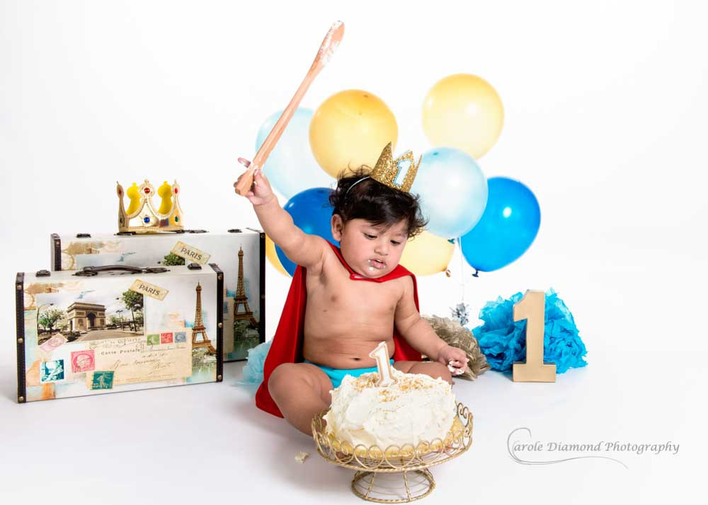 smashing birthday cake with wooden spoon little prince cake smash