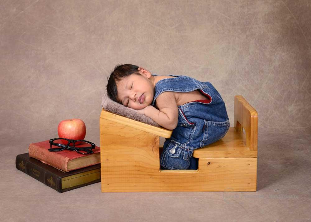sleeping newborn at school desk
