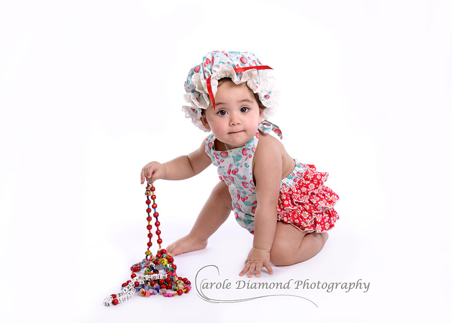 Gorgeous 11 month Scarlet Grace with her heart beads - A Heartkids national project!