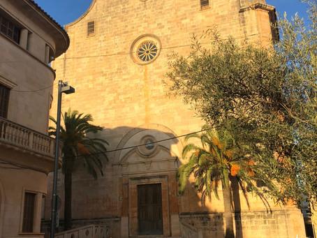 Santanyí's massive Church Fassade in the Golden Sunset Light.