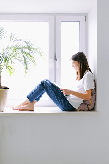 woman-in-white-shirt-and-blue-denim-jean