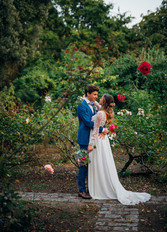 Long-sleeve wedding gown with an open back, 3D lace flowers and matching chapel-length veil. Featuring a flowy chiffon skirt with satin lining, a split, gathers center back and a modest train. Bespoke and one of a kind, by Lilli Turner Couture  Photography: Gauthier Le Guen